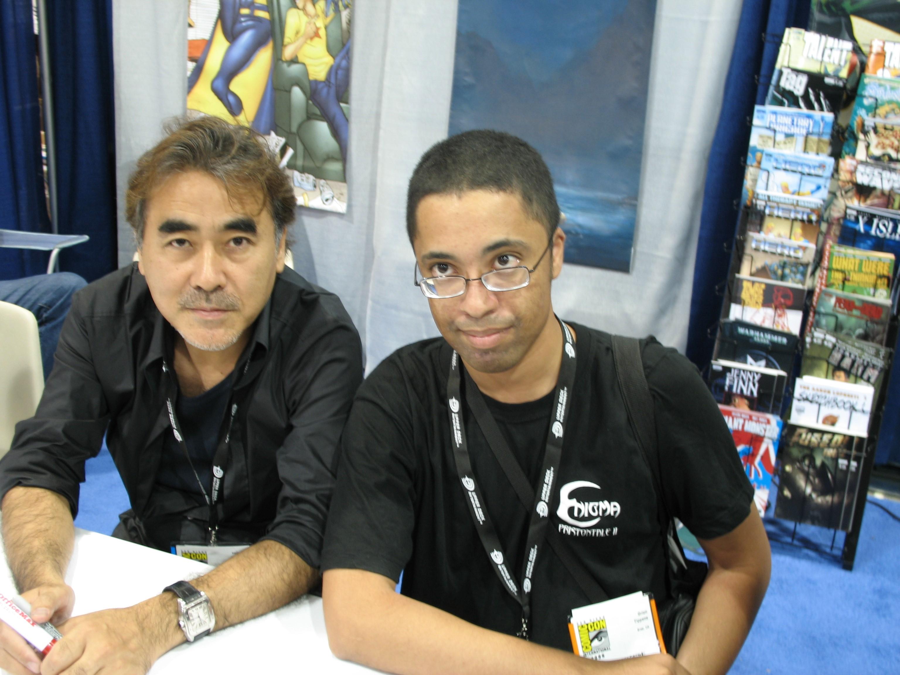 Yoshitaka Amano (left) andme